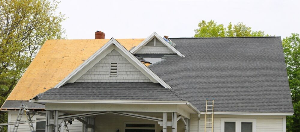 Home undergoing new roof installation