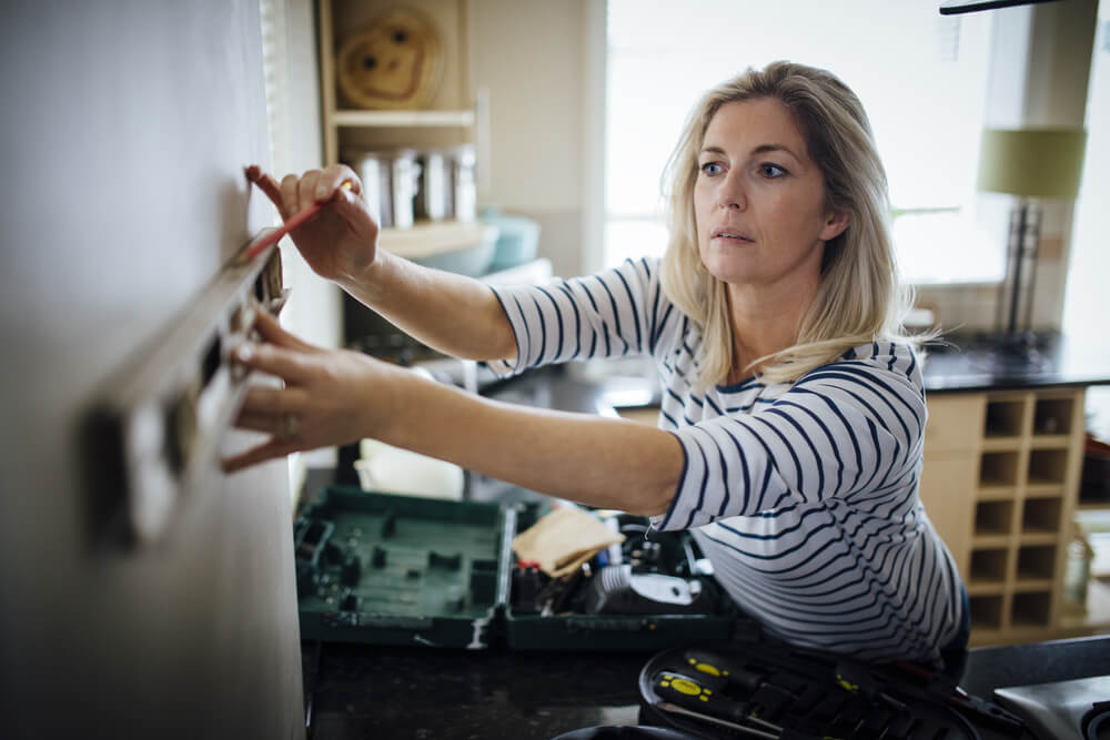 Woman doing DIY Home Improvement
