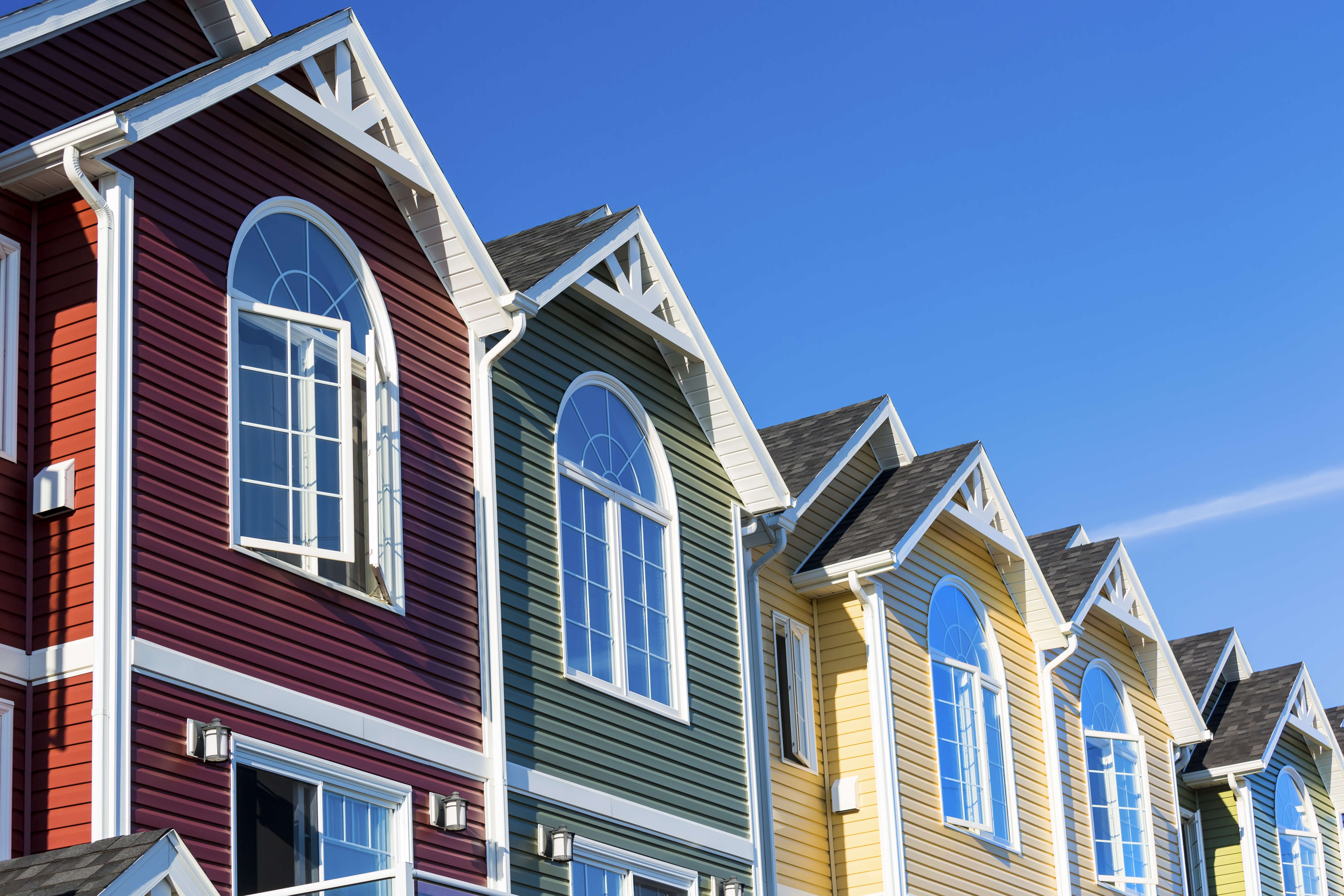 Colorful vinyl siding on townhomes